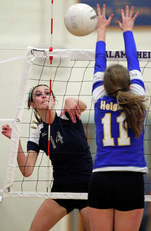The Chargers' Emily Johnson gets a shot past the Lady Mules' Lauren Brockwell as Boerne Champion beats Alamo Heights 3-0 in volleyball at the Alamo Heights gym on Tuesday, Oct. 23, 2012. Photo: Tom Reel,  San Antonio Express-News / ©2012 San Antono Express-News