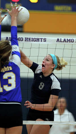 The Chargers' Claire Kreuz slams a shot into the Lady Mules' Sloan Evans as Boerne Champion beats Alamo Heights 3-0 in volleyball at the Alamo Heights gym on Tuesday, Oct. 23, 2012. Photo: Tom Reel,  San Antonio Express-News / ©2012 San Antono Express-News