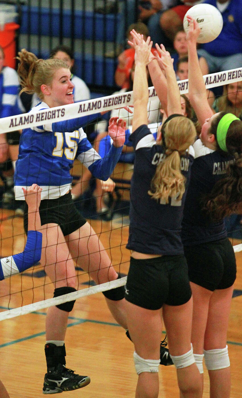 The Lady Mules' McKay Kyle pops a shot past the Chargers as Boerne Champion beats Alamo Heights 3-0 in volleyball at the Alamo Heights gym on Tuesday, Oct. 23, 2012.