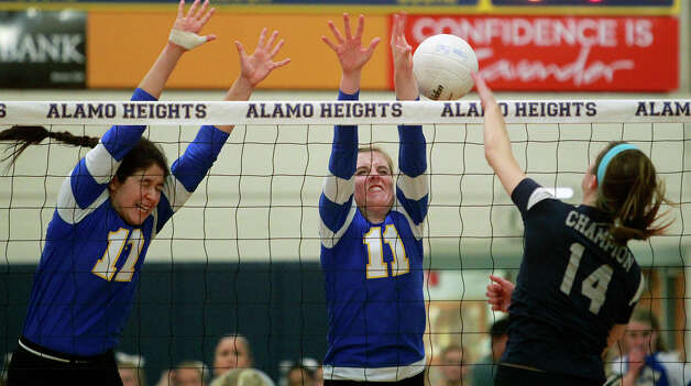 Alamo Heights' Jackie Cabello (left) and Lauren Brockwell defend the net against Champion's Emily Johnson, who secured a Game 2 win with a block. Photo: Tom Reel,  San Antonio Express-News / ©2012 San Antono Express-News