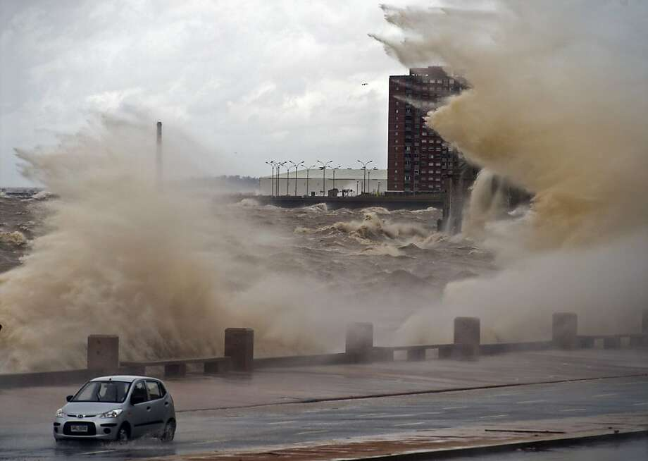 Waves crash on Montevideo's waterfront amid a storm that brought 