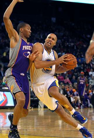 Richard Jefferson #44 of the Golden State Warriors drives against the Phoenix Suns Wesley Johnson #2 at Oracle Arena on Tuesday, October 23, 2012 in Oakland, California. Photo: Lance Iversen, The Chronicle