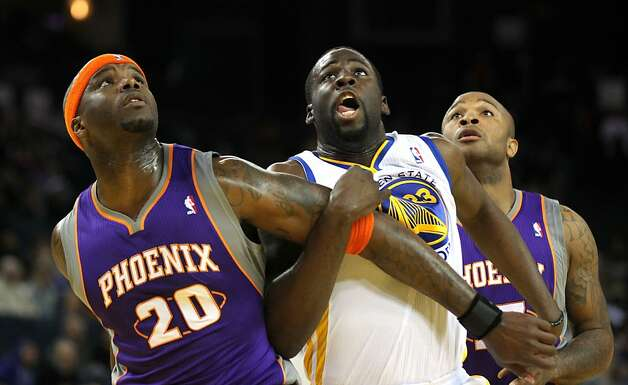Draymond Green #23 of the Golden State Warriors is guarded by Phoenix Suns Jermaine O'Neal and P.J. Tucker #17 at Oracle Arena on Tuesday, October 23, 2012 in Oakland, California. Photo: Lance Iversen, The Chronicle