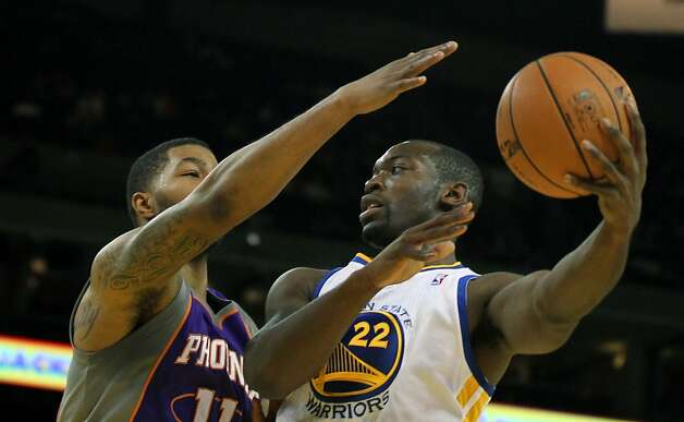 Charles Jenkins #22 of the Golden State Warriors drives against the Phoenix Suns Markieff Morris #11 at Oracle Arena on Tuesday, October 23, 2012 in Oakland, California. Photo: Lance Iversen, The Chronicle
