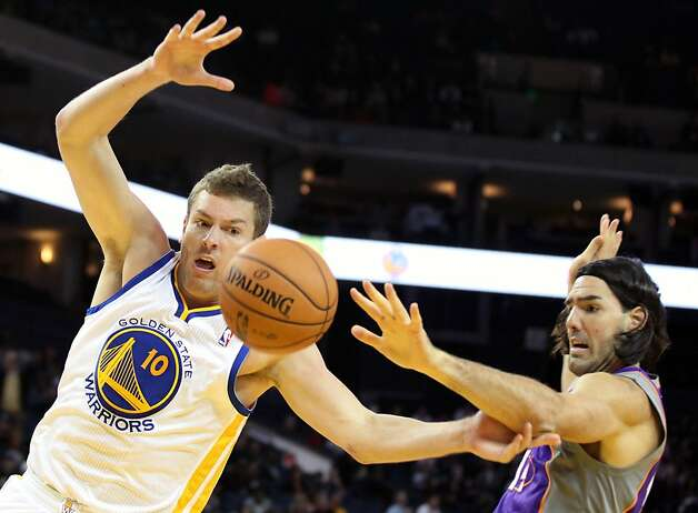 Davis Lee #10 of the Golden State Warriors is fouled by Phoenix Suns Luis Scola at Oracle Arena on Tuesday, October 23, 2012 in Oakland, California. Photo: Lance Iversen, The Chronicle