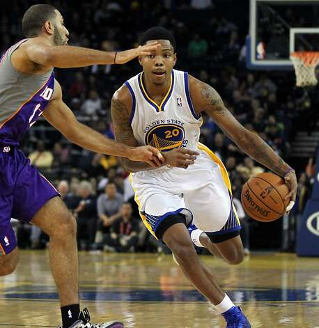 Kent Bazemore #20 of the Golden State Warriors drives against the Phoenix Suns in the 4th period at Oracle Arena on Tuesday, October 23, 2012 in Oakland, California. Warriors won 107-92 Photo: Lance Iversen, The Chronicle