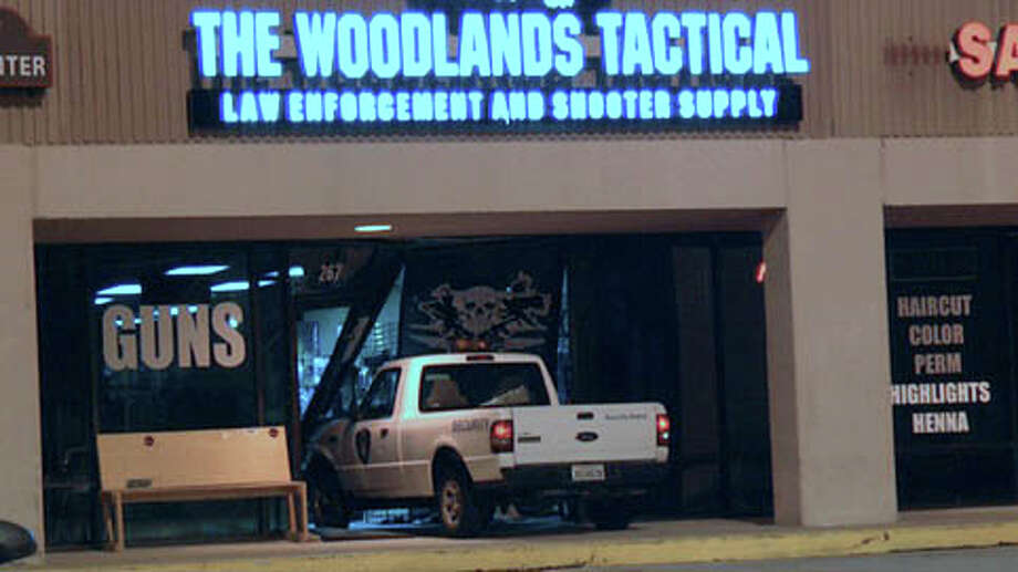 Two men armed with assault weapons stole a security guard's business pickup and smashed it into this gun shop just after midnight Wednesday. (Scott J. Engle / Montgomery County Police Reporter) Photo: Montgomery County Police Reporter