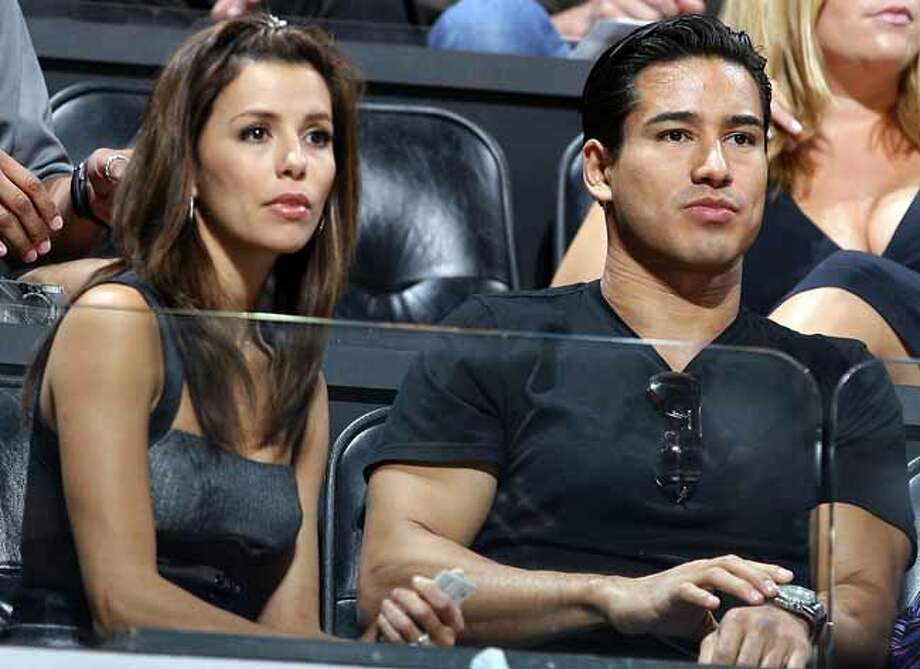Eva Longoria and Mario Lopez watch the Spurs Panathinaikos game Saturday Oct. 13, 2007 at the AT&T Center. Think she's still a fan? Photo: EDWARD A. ORNELAS, SAN ANTONIO EXPRESS-NEWS / SAN ANTONIO EXPRESS-NEWS