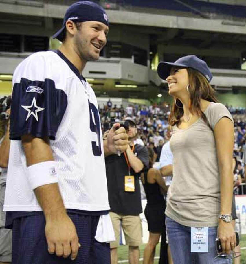 Dallas Cowboys' quarterback Tony Romo (left) talks with Eva Longoria Parker after morning practice Saturday Aug. 8, 2009 at the Alamodome. She told USA Today that she is a