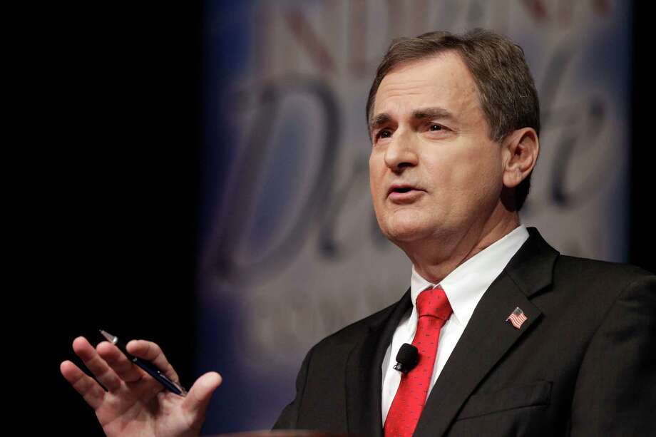 """Republican Richard Mourdock, candidate for Indiana's U.S. Senate seat, participates in a debate with Democrat Joe Donnelly  and Libertarian Andrew Horning in a debate in New Albany, Ind., Tuesday, Oct. 23, 2012. Mourdock said Tuesday when a woman is impregnated during a rape, """"it's something God intended."""" He was asked during the final minutes of the debate whether abortion should be allowed in cases of rape or incest. (AP Photo/Michael Conroy) Photo: Michael Conroy, STF / AP"""