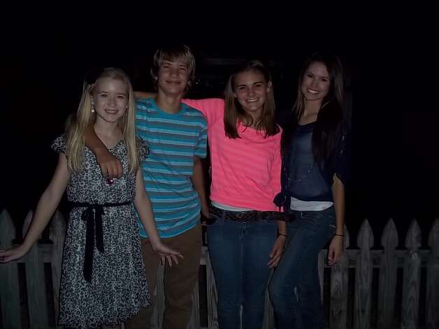 In 2004, cousins Madison Saulter (from left), Logan Saulter, Samantha Schulte and Kierstan Saulter took a photo at the home of their great aunt/grandmother Bonnie Keller in Castroville as they remembered their great-grandmother Fanny Keller, who died that year. In this photo, taken in 2012, the cousins are all teenagers, yet they still get together each September to honor their great-grandmother. The day includes a mass at St. Louis Church in Castroville followed by a family get-together and supper. Photo: Bonnie Keller, Reader Submission