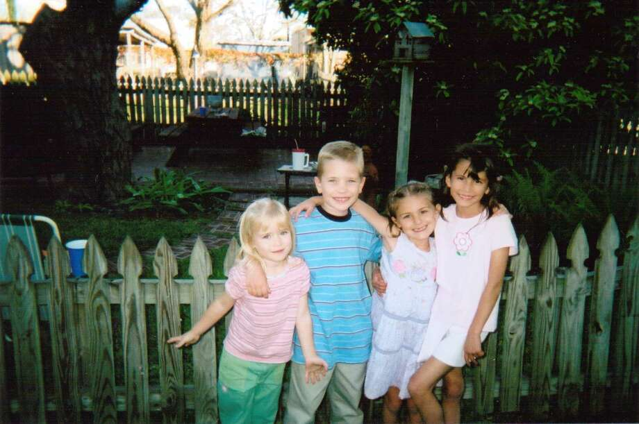 In this photo taken in 2004, cousins Madison Saulter (from left), Logan Saulter, Samantha Schulte and Kierstan Saulter get together at the home of their great aunt/grandmother Bonnie Keller in Castroville to remember their great-grandmother Fanny Keller, who died that year. Photo: Bonnie Keller, Reader Submission
