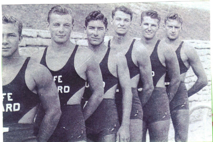 Dr. Buck Rikli as a  life guard with other life guards at Naperville, Illinois swimming pool in  194