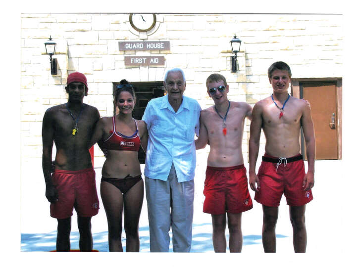 Dr. Buck Rikli, 94 years old, poses with today life guards at Naperville, Illinois swimming pool.