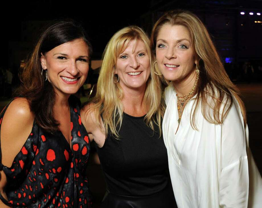 From left: Deanna Barton, Alyssa Lyle and Paige Fertitta at the HPD True Blue Gala benefitting the Houston Police Foundation at the Landry's Flight Hanger at Hobby Airport Saturday Oct. 20,2012.(Dave Rossman photo) Photo: Dave Rossman, Freelance / © 2012 Dave Rossman