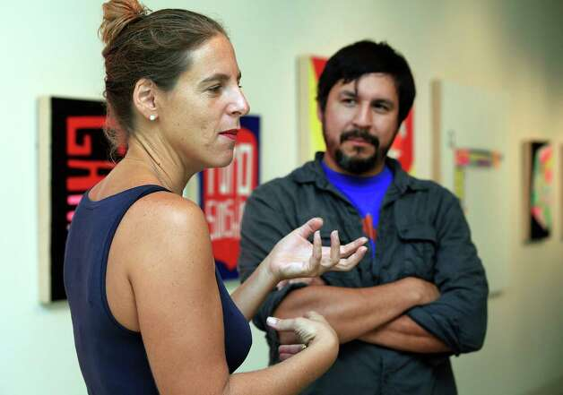 San Antonio artist Cruz Ortiz, right, listens as curator Kate Green discribes his show.  Ortiz is having a solo exhibition at the UT Visual Art Center in Austin.  Thursday, Sept. 20, 2012. Photo: BOB OWEN, San Antonio Express-News / © 2012 San Antonio Express-News