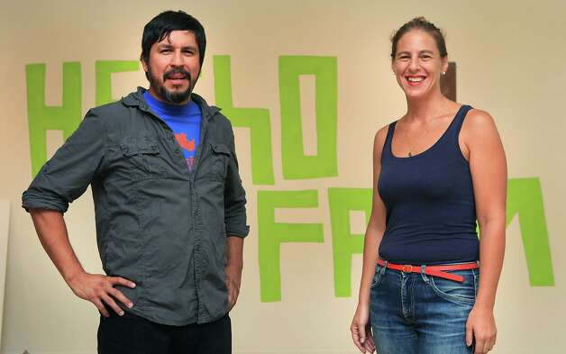 "San Antonio artist Cruz Ortiz, left, is seen with curator Kate Green in front of ""hecho farm"", a piece in Ortiz's solo exhibition at the UT Visual Art Center in Austin.  Thursday, Sept. 20, 2012. Photo: BOB OWEN, San Antonio Express-News / © 2012 San Antonio Express-News"