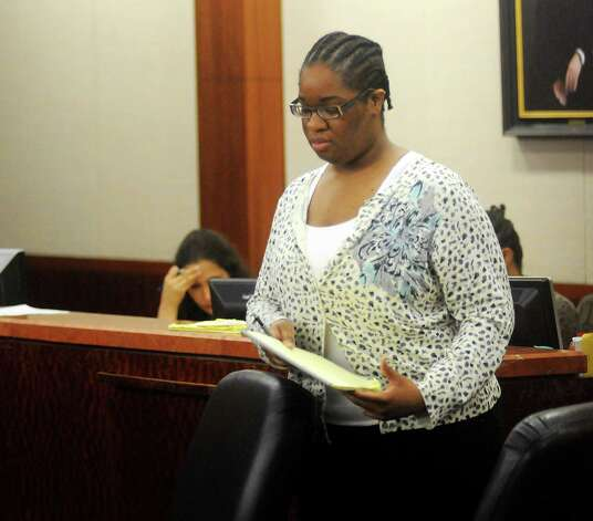Jessica Tata takes a seat during pretrial hearings in the 180th state district court Monday Oct. 15,2012.(Dave Rossman photo) Photo: Dave Rossman, Freelance / © 2012 Dave Rossman