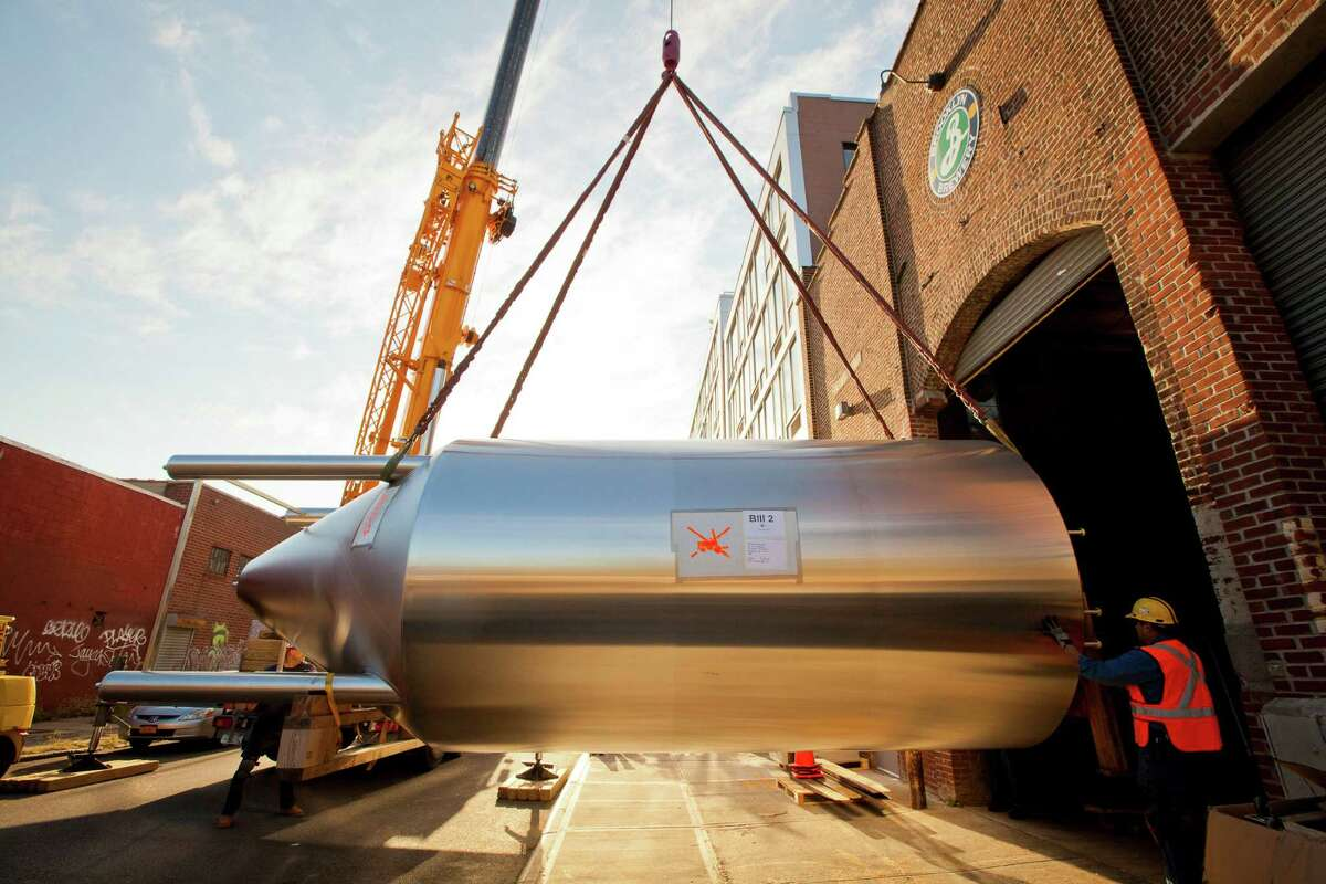 One of eight new fermentation tanks from Bavaria is installed at the Brooklyn Brewery in New York, Oct. 23, 2012. The tanks will allow the brewing company to double its production. (Angel Franco/The New York Times)