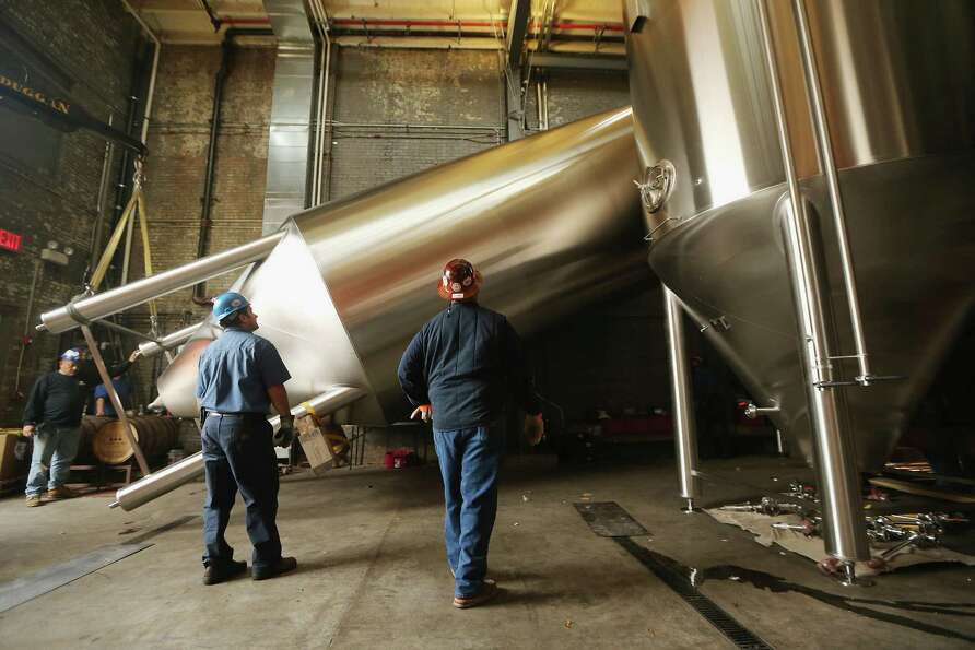 NEW YORK, NY - OCTOBER 23:  Workers install a 25-foot tall fermenter at Brooklyn Brewery on October