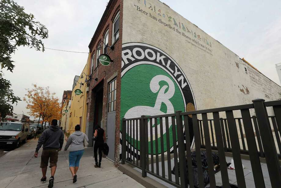 NEW YORK, NY - OCTOBER 23:  People walk past Brooklyn Brewery on October 23, 2012 in the Brooklyn borough of New York City. A total of nine fermenters are being installed this week which will allow the craft brewery to make 100,000 barrels of beer per year, 24 hours a day. A mid-year report by the Brewer's Association cited a 12 percent increase in craft beer sales to 6 million barrels this year. The number of American breweries have surged to a 125-year-high of 2,126 breweries last year, 97 percent of which are independent craft breweries.  During the pre-Prohibition era Brooklyn had more than 45 breweries and was one of the largest brewing centers in the U.S., today Brooklyn Brewery is the only brewery in the borough. Photo: Mario Tama, Getty Images / 2012 Getty Images