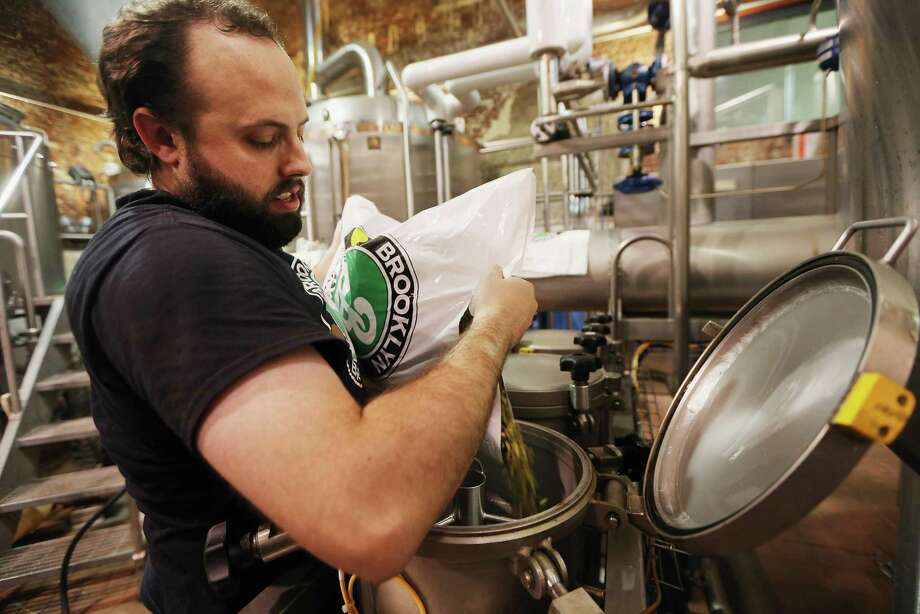 NEW YORK, NY - OCTOBER 23:  Production manager Jimmy Valm adds hops to the boil in the brewhouse at Brooklyn Brewery on October 23, 2012 in the Brooklyn borough of New York City. A total of nine fermenters are being installed this week which will allow the craft brewery to make 100,000 barrels of beer per year, 24 hours a day. A mid-year report by the Brewer's Association cited a 12 percent increase in craft beer sales to 6 million barrels this year. The number of American breweries have surged to a 125-year-high of 2,126 breweries last year, 97 percent of which are independent craft breweries.  During the pre-Prohibition era Brooklyn had more than 45 breweries and was one of the largest brewing centers in the U.S., today Brooklyn Brewery is the only brewery in the borough. Photo: Mario Tama, Getty Images / 2012 Getty Images