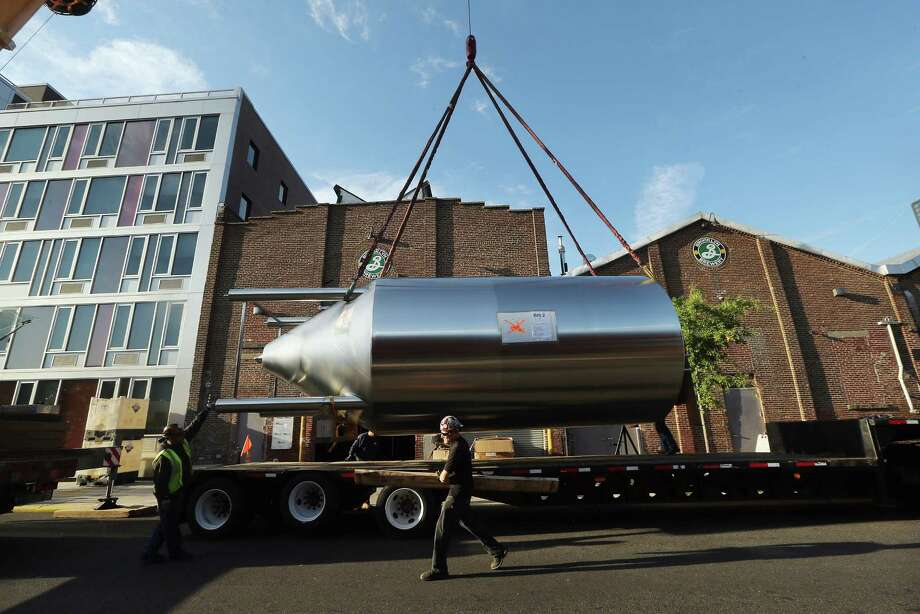 NEW YORK, NY - OCTOBER 23:  Workers prepare to install a 25-foot tall fermenter at Brooklyn Brewery on October 23, 2012 in the Brooklyn borough of New York City. A total of eight fermenters are being installed this week which will allow the craft brewery to make 100,000 barrels of beer per year, 24 hours a day. A mid-year report by the Brewer's Association cited a 12 percent increase in craft beer sales to 6 million barrels this year. The number of American breweries have surged to a 125-year-high of 2,126 breweries last year, 97 percent of which are independent craft breweries.  During the pre-Prohibition era Brooklyn had more than 45 breweries and was one of the largest brewing centers in the U.S., today Brooklyn Brewery is the only brewery in the borough. Photo: Mario Tama, Getty Images / 2012 Getty Images