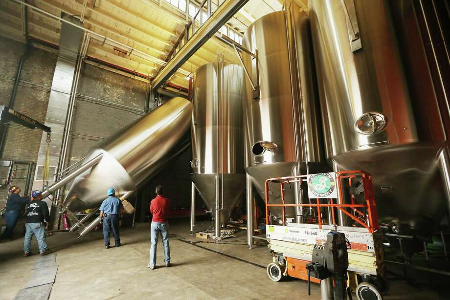 NEW YORK, NY - OCTOBER 23:  Workers install a 25-foot tall fermenter at Brooklyn Brewery on October 23, 2012 in the Brooklyn borough of New York City. A total of eight fermenters are being installed this week which will allow the craft brewery to make 100,000 barrels of beer per year, 24 hours a day. A mid-year report by the Brewer's Association cited a 12 percent increase in craft beer sales to 6 million barrels this year. The number of American breweries have surged to a 125-year-high of 2,126 breweries last year, 97 percent of which are independent craft breweries.  During the pre-Prohibition era Brooklyn had more than 45 breweries and was one of the largest brewing centers in the U.S., today Brooklyn Brewery is the only brewery in the borough. Photo: Mario Tama, Getty Images / 2012 Getty Images