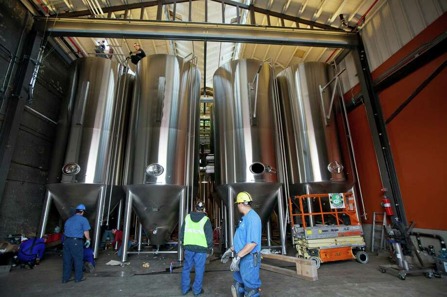 Four of eight new fermentation tanks from Bavaria installed at the Brooklyn Brewery in New York, Oct. 23, 2012. The tanks will allow the brewing company to double its production. (Angel Franco/The New York Times) Photo: ANGEL FRANCO, NYT / NYTNS