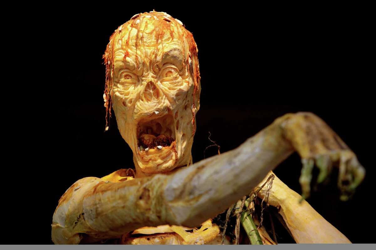 A zombie carved from giant pumpkins is displayed at the New York Botanical Gardens in New York, Tuesday, Oct. 23, 2012. This carving and other halloween themed pumpkins will be on display through Oct. 31, 2012.
