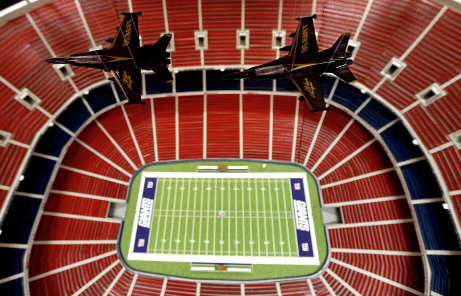 Model Blue Angel fighter jets hang from the ceiling symbolizing a flyover of Don Martini's replica of Giants Stadium, the former home of the New York Football Giants, Tuesday, Oct. 23, 2012, in his garage in Blairstown, N.J. According to Martini, the replica took him two years to build and is pretty close to what the actual stadium looked like before it was demolished. Photo: Julio Cortez, AP / AP