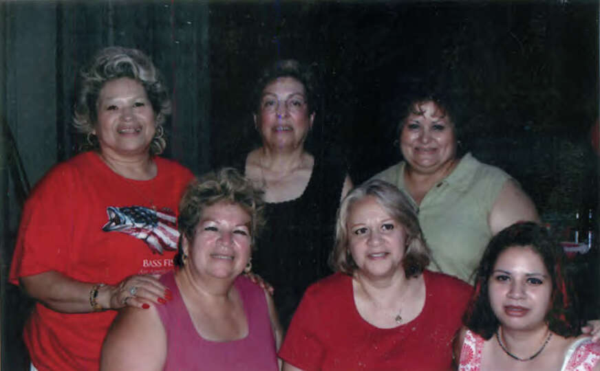 Attached is a photo all my sister-in-laws at a family gathering in 2001. They are (back row): Olga G