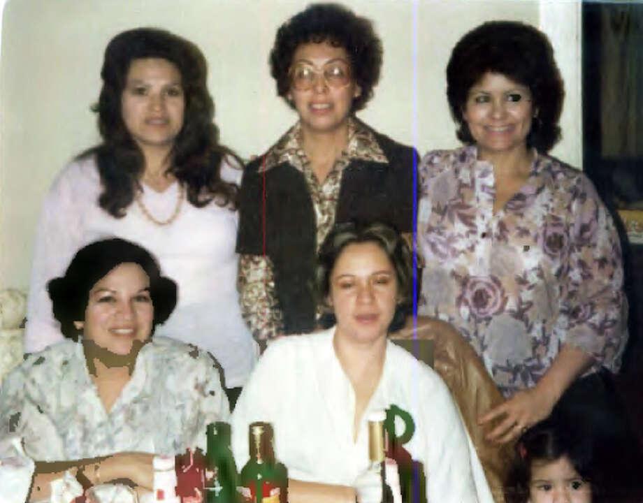 Then: Sister-in-laws at a family gathering in 1970. They are (back row): Olga Garcia, Elida Sanchez, Maria Elena Sanchez, and (front row): Maria Guajarado, Celia Sanchez, and Niece Gina Sanchez. --Elida Sanchez Photo: Elida Sanchez, Reader Submission