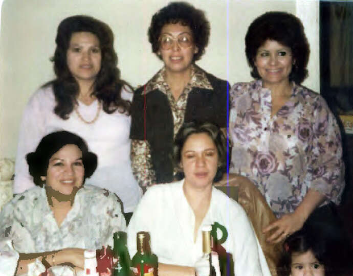 Attached is a photo of sister-in-laws at a family gathering in 1970. They are (back row): Olga Garci