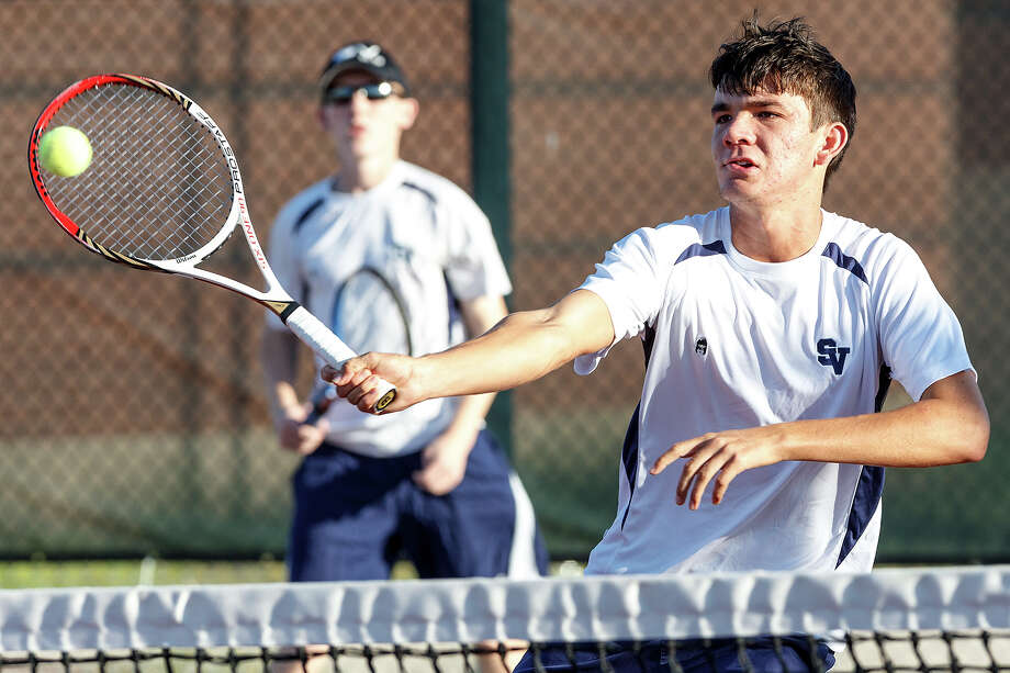 Smithson Valley's Brandon Adkins returns a ball at the net as Cole Nipper looks on in boys doubles during their District 25-5A tennis match with Judson at Judson High School on Oct. 18, 2012.  Photo by Marvin Pfeiffer Photo: MARVIN PFEIFFER, Marvin Pfeiffer / Prime Time New / Prime Time Newspapers 2012