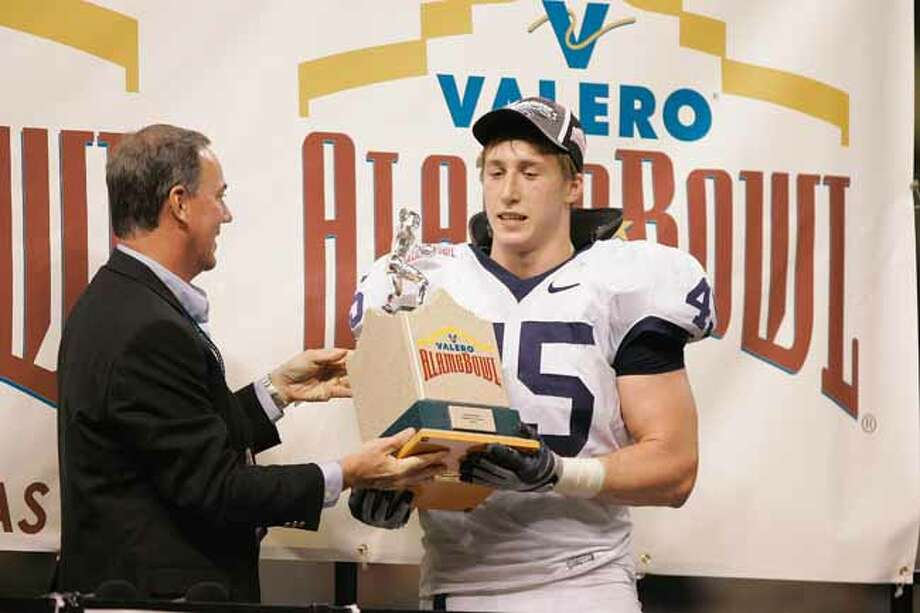 Sean Lee #45 of the Penn State Nittany Lions holds the trophy after defeating the Texas A&M Aggies in the Valero Alamo Bowl on December 29, 2007 at the Alamodome in San Antonio, Texas. Penn State won 24-17. (Photo by Brian Bahr/Getty Images) Photo: Brian Bahr, Getty Images / 2007 Getty Images