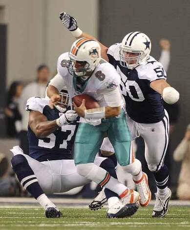 Cowboys linebackers Victor Butler, left, and Sean Lee sack Miami quarterback Matt Moore during first-half NFL action at Cowboys Stadium on Thanksgiving Day, Nov. 24, 2011. BILLY CALZADA / gcalzada@express-news.netMiami Dolphins at Dallas Cowboys Photo: BILLY CALZADA, SAN ANTONIO EXPRESS-NEWS / gcalzada@express-news.net