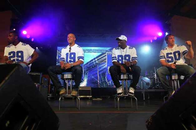 From left, players DeMarco Murray, Miles Austin, Dez Bryant, and Sean Lee take the stage for a Q&A session with Brad Sham, voice of the Cowboys, during Cowboys Fan Fest at Sunset Station, Sunday, May 7, 2012. (JENNIFER WHITNEY) Photo: JENNIFER WHITNEY, SPECIAL TO THE EXPRESS-NEWS / SAN ANTONIO EXPRESS-NEWS