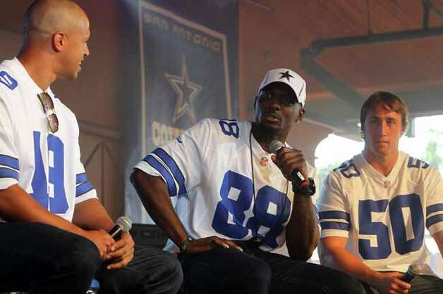 Miles Ausin, left, and Sean Lee, right, look on as Dez Bryant speaks during a Q&A session at Cowboys Fan Fest at Sunset Station, Sunday, May 7, 2012. (JENNIFER WHITNEY) Photo: JENNIFER WHITNEY, SPECIAL TO THE EXPRESS-NEWS / SAN ANTONIO EXPRESS-NEWS