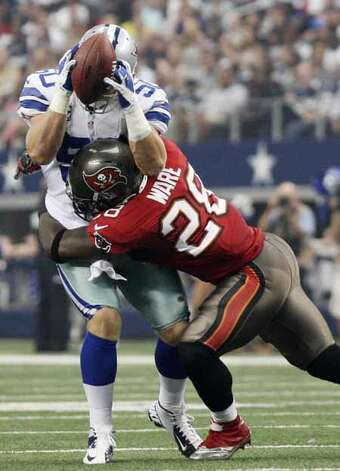Dallas Cowboys's linebacker Sean Lee intercepts a pass as Tampa Bay Buccaneers' running back D.J. Ware tackles him during the first half at Cowboys Stadium in Arlington, Texas, Sunday Sept. 23, 2012. The interception led to the Cowboys' only touchdown of the game. They won 16-10. Photo: Jerry Lara, San Antonio Express-News / © 2012 San Antonio Express-News