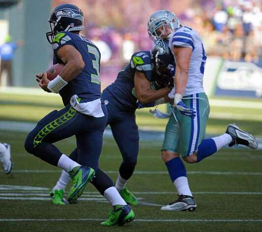 Dallas Cowboys inside linebacker Sean Lee (50) gets his bell rung by Seattle Seahawks wide receiver Golden Tate (81) as Seattle Seahawks quarterback Russell Wilson (3) scrambles during the third quarter. The Seattle Seahawks beat the Dallas Cowboys, 27-7, at CenturyLink Field in Seattle, Washington, Sunday, September 16, 2012. (Max Faulkner/Fort Worth Star-Telegram/MCT) Photo: Max Faulkner, McClatchy-Tribune News Service / Fort Worth Star-Telegram