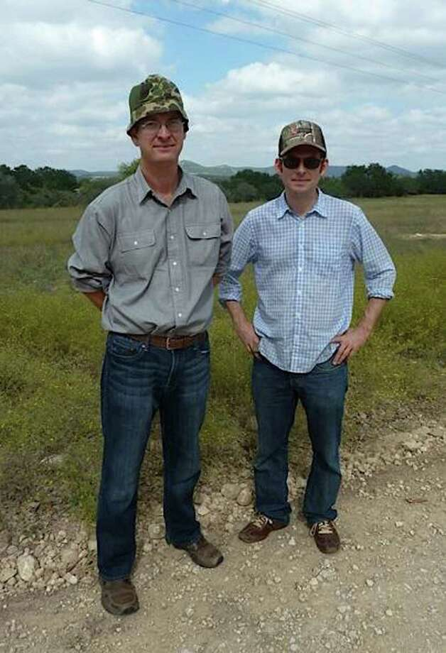 Now: William, left, and brother Maverick Fisher are kitted out in camo to hunt at the family's Piquines Ranch in Tarpley, Tex., in 2012, re-creating a similar photo they'd taken a quarter-century earlier. William still lives in San Antonio, Maverick in Austin. Both lawyers, they still relish trips to Piquines whenever time allows.