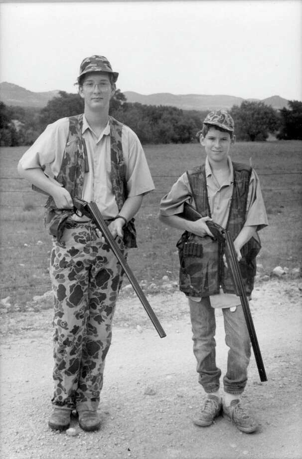 William, left, and brother Maverick Fisher were kitted out in camo to hunt at the family's Piquines Ranch in Tarpley, Texas in 1987. --Mary Fisher Photo: Mary Fisher, Reader Submission