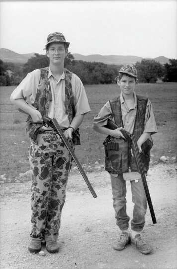 William, left, and brother Maverick Fisher were kitted out in camo to hunt at the family's Piquines