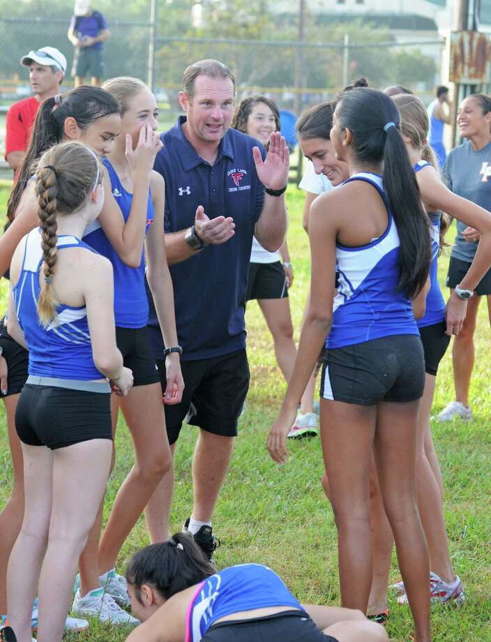 Clear Lake girls cross country coach James Menze gets his team pumped up prior to the Clear Creek ISD Meet on Sept. 28, 2012 at Walter Hall Park in League City. Photo: L. Scott Hainline / freelance