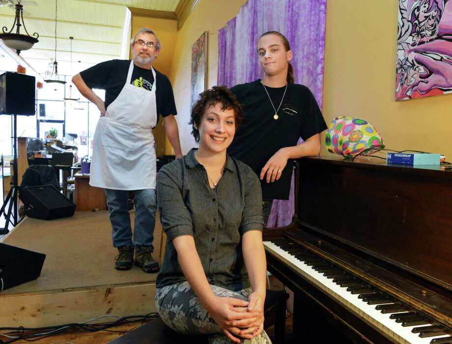 New owners the More Bread and Jam Cafe, from left, Steve Kolcow, Brooke Kolcow and Stefan Kolcow on the stage of the Remsen Street Cohoes cafe Thursday Oct. 18, 2012.  (John Carl D'Annibale / Times Union) Photo: John Carl D'Annibale / 00019724A
