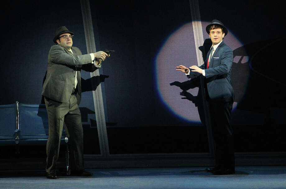 "Merritt David Janes (left) as Agent Carl Hanratty and Stephen Anthony as Frank Abagnale Jr. star in ""Catch Me If You Can,"" which continues through Sunday at the Majestic Theatre. Photo: Kin Man Hui, San Antonio Express-News / © 2012 San Antonio Express-News"