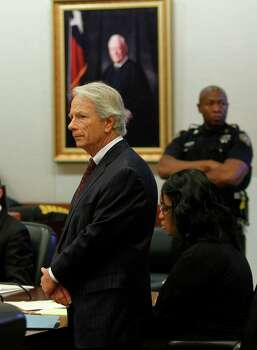 Defense Attorney Mike DeGeurin stands next to Jessica Tata before opening statements at the Harris County Criminal Courthouse on Wednesday, Oct. 24, 2012, in Houston.  Jessica Tata is accused in the deaths of four children at her west Houston daycare. Photo: Mayra Beltran, Houston Chronicle / © 2012 Houston Chronicle