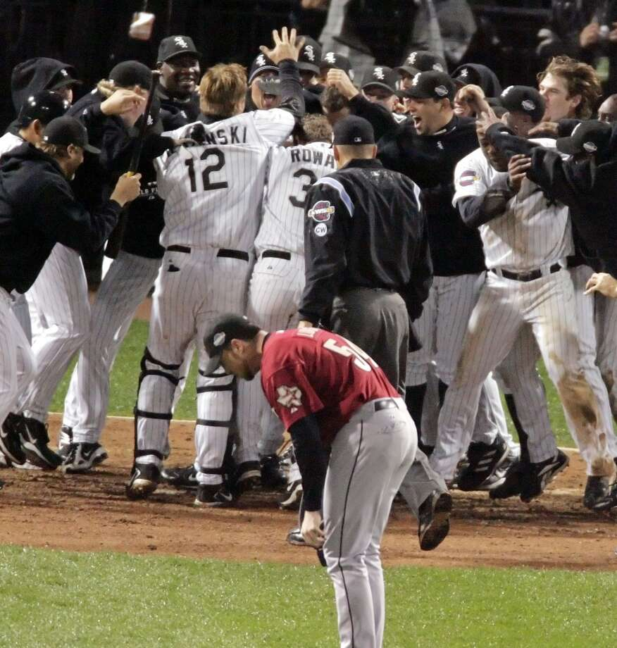 Houston Astros pitcher Brad Lidge hangs his head as the Chicago White Sox celebrate Scott Podsednik's game-winning homw run off in Game 2. (Chronicle)