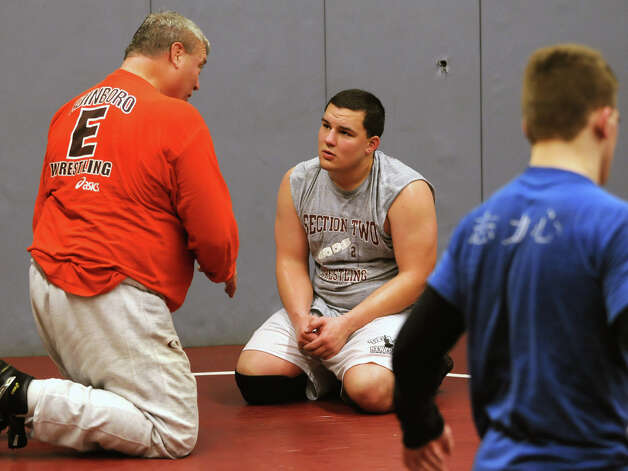 Former Olympian Jeff Blatnick, left, works with Burnt Hills wrestler Zeal McGrew during practice in Burnt Hills, NY on December 18, 2009. Photo: LORI VAN BUREN, Times Union / 00006885A